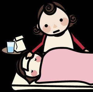 寝ている子供を看病する母